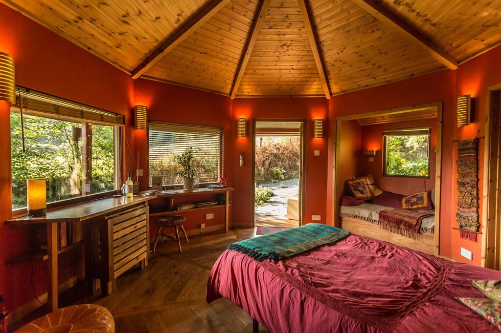 inside-a-circular-red-and-orange-glamping-cabin-nant-yr-onnen-cabin-llandovery,-carmarthenshire