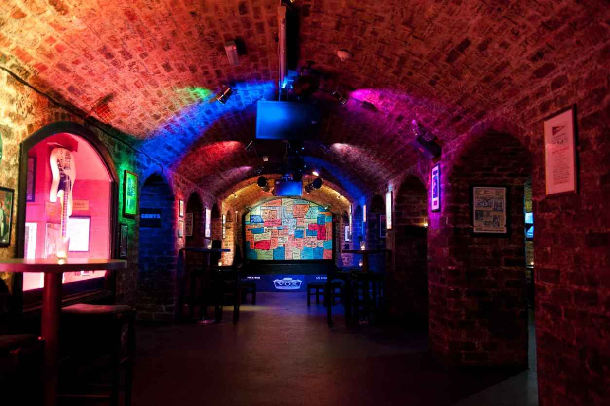 inside-of-the-cavern-club-stage-lit-up-in-neon-lights