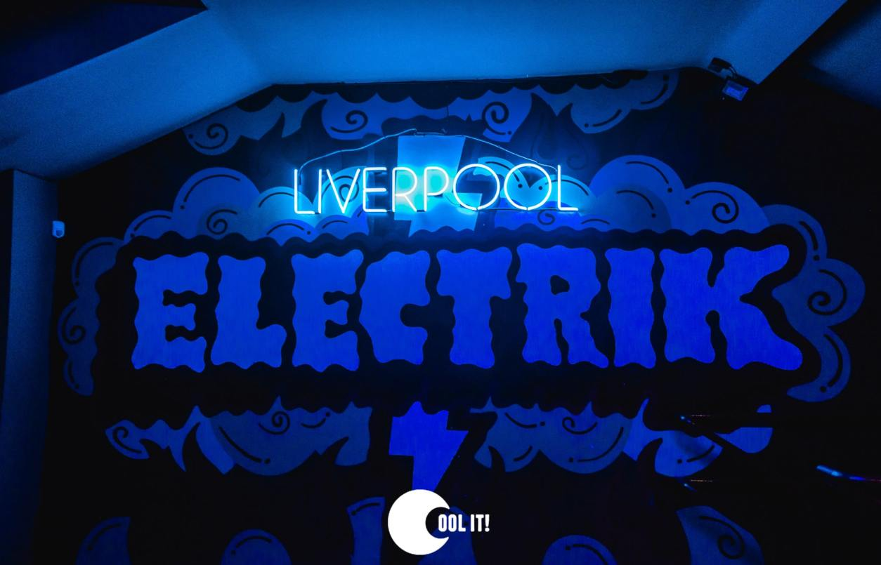 liverpool-electrick-warehouse-sign-lit-up-in-dark-in-neon-blue