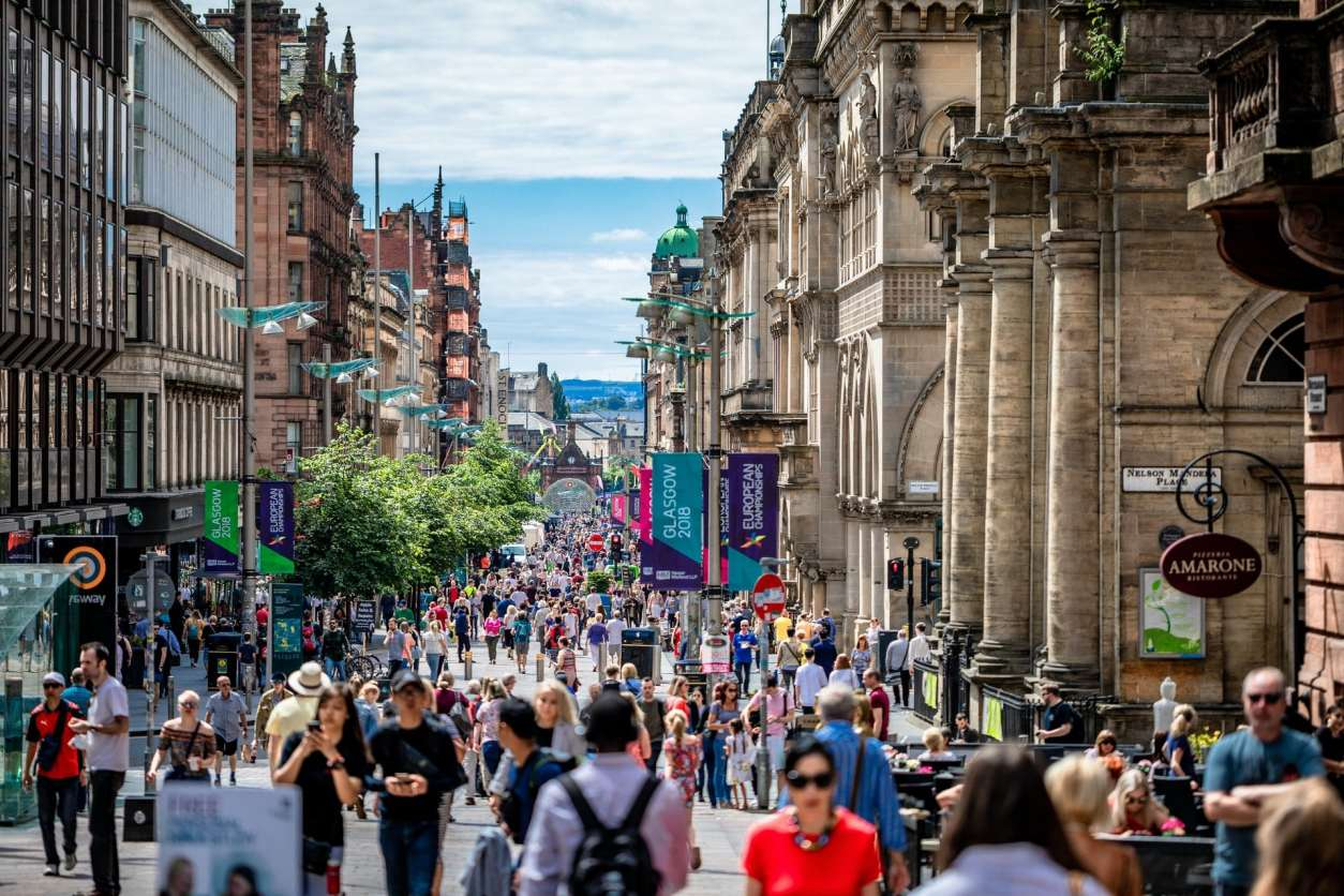 lots-of-people-walking-down-busy-city-centre-high-street-on-a-summers-day-buchanan-street-2-days-in-glasgow