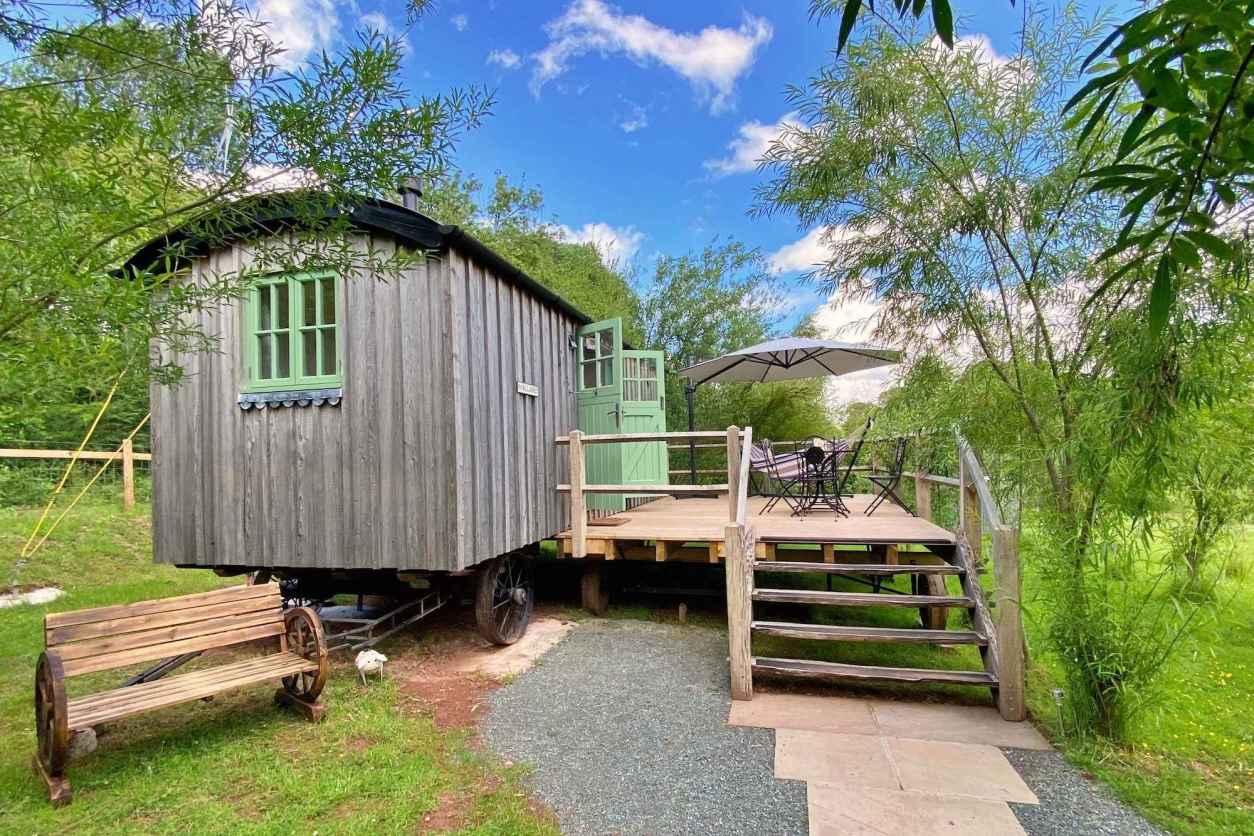 sennybridge-shepherds-huts-with-decking-in-grassy-field-in-brecon-powys