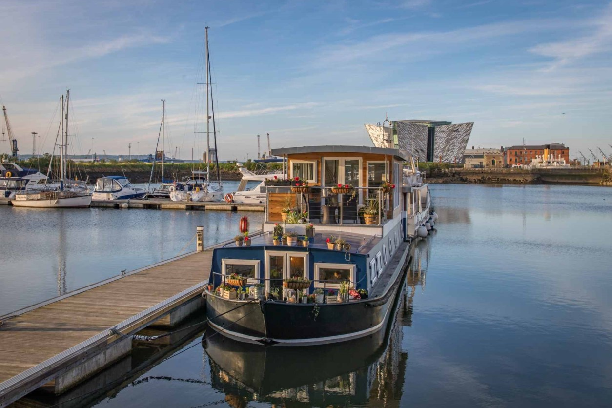 barge-at-titanic-houseboat-docked-on-harbour