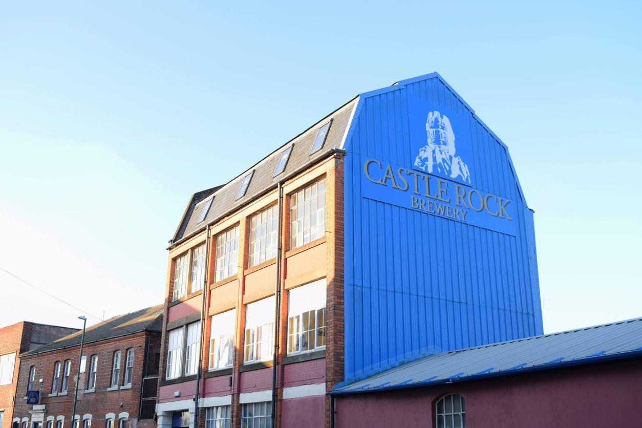 castle-rock-brewery-against-blue-sky