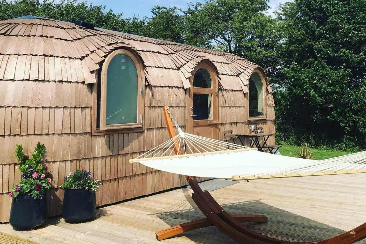 hammock-on-decking-outside-lydcott-glamping-cabin-in-looe