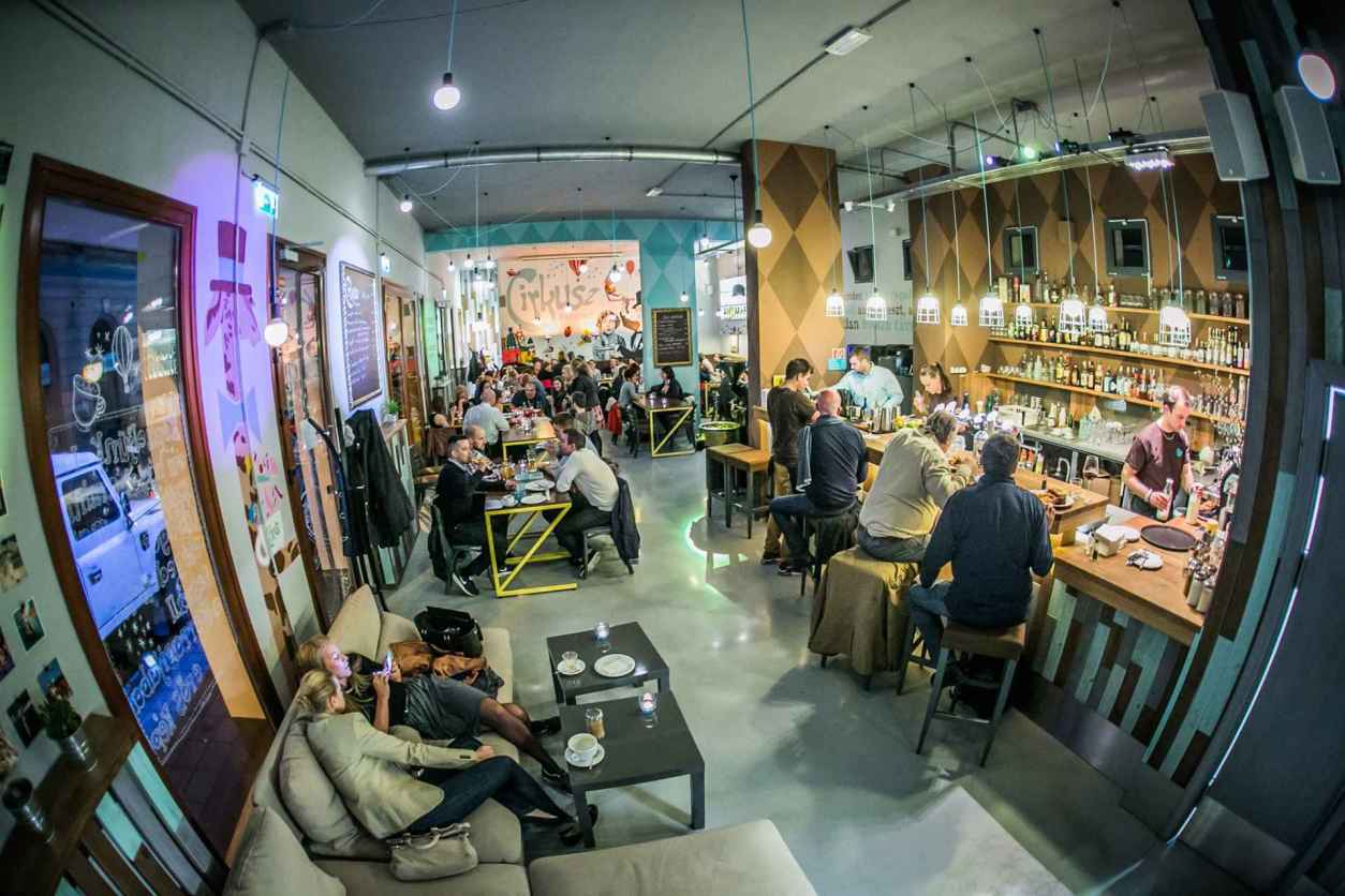 people-sat-around-eating-and-drinking-in-cafe-bar-cirkusz-café