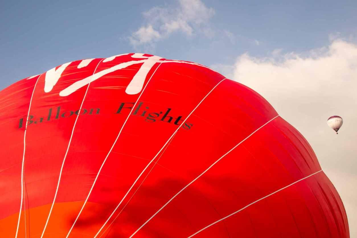 red-virgin-hot-air-balloon-inflating