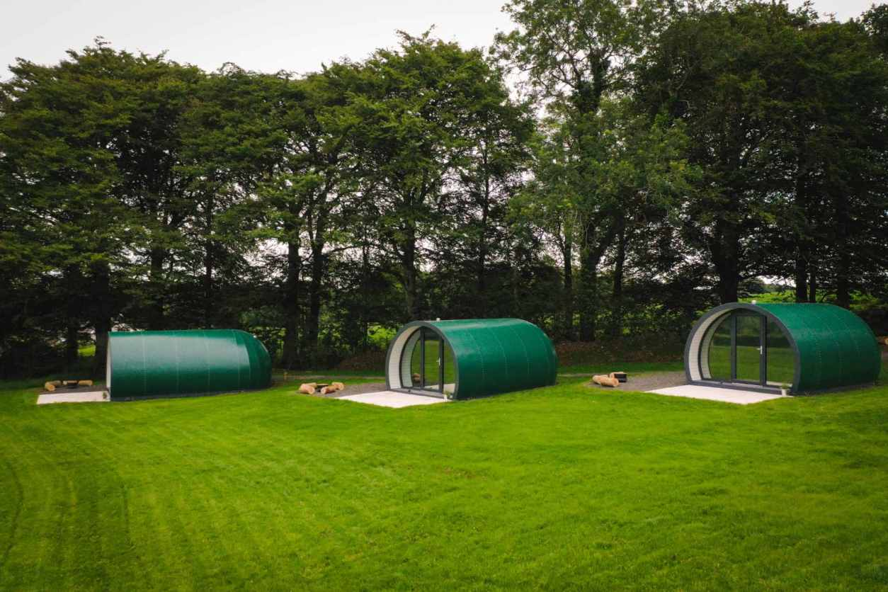 three-cylinder-glamping-pods-in-field-at-further-space-thornfield-dark-hedges-glamping-northern-ireland