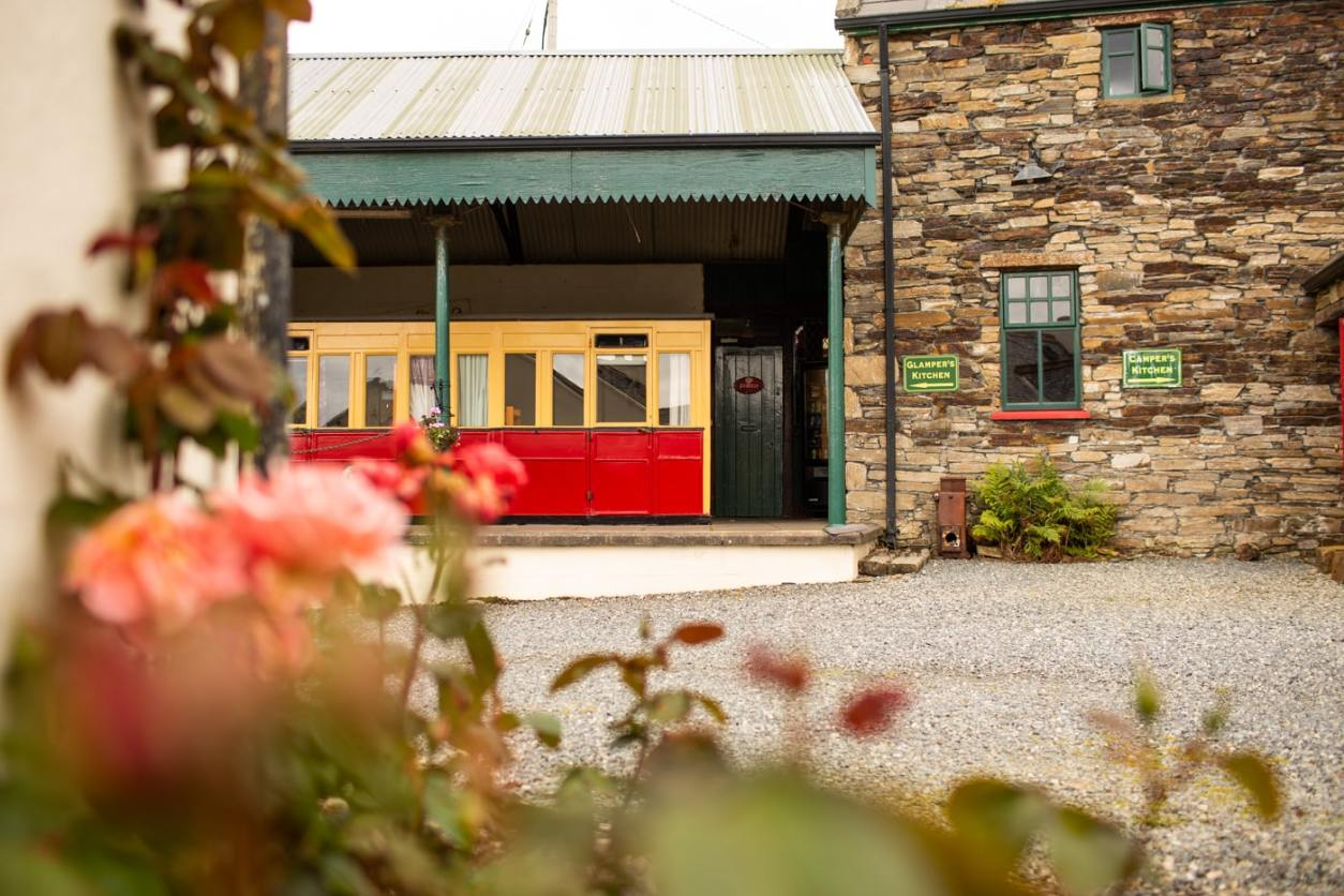 yellow-and-red-railway-carriage-accommodation-at-corcreggan-mill