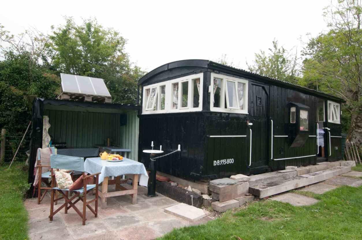 black-brake-carriage-in-garden-in-glastonbury