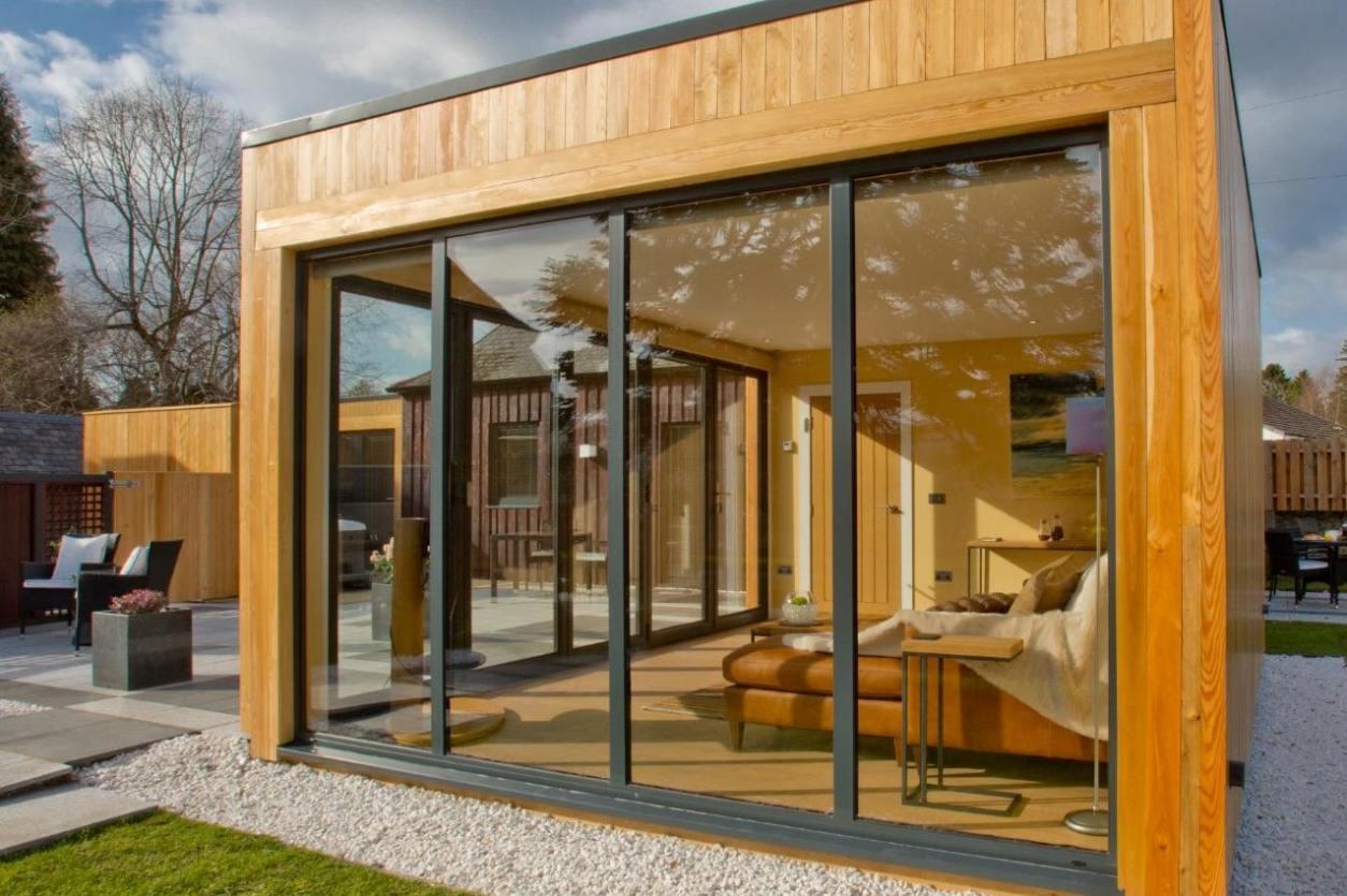 glass-sliding-doors-of-small-house-in-garden-invergarry-aboyne