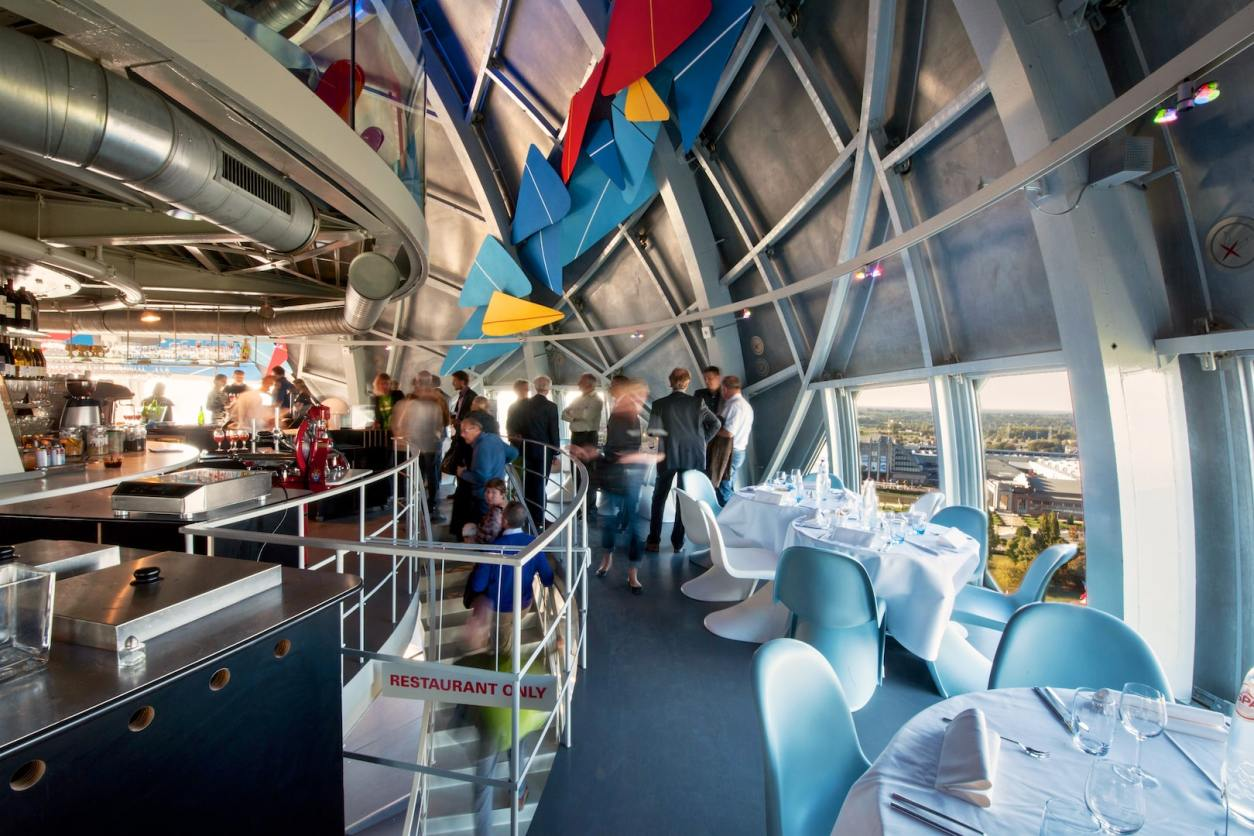 groups-of-people-standing-in-restaurant-at-atomium