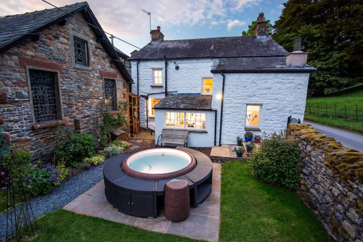 hot-tub-in-garden-of-the-weathercock.-detached-cottage-at-sunset-airbnbs-lake-district