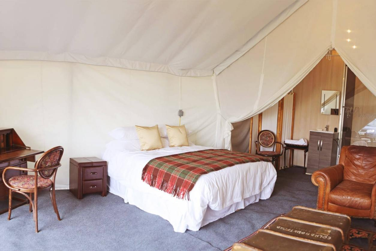 large-double-bedroom-with-trunk-and-seat-in-cloud-nine-safari-tent