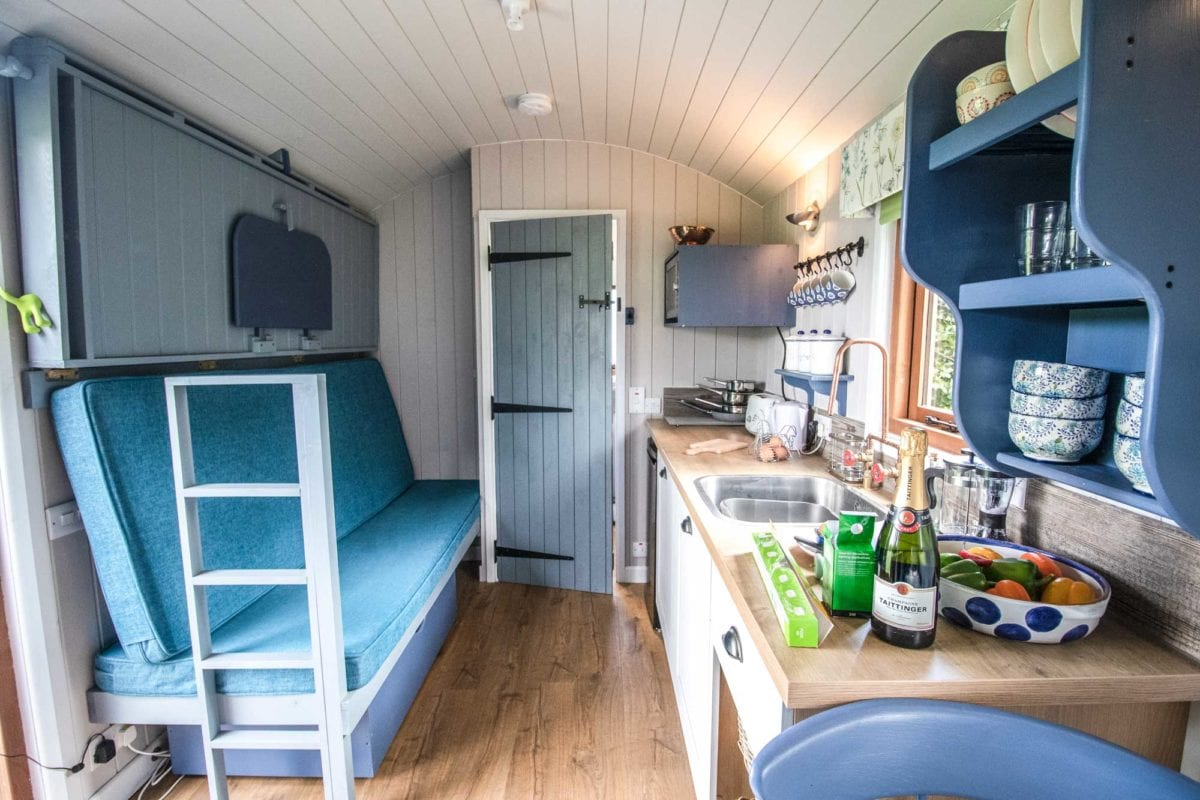 living-and-kitchen-area-inside-teasel-at-south-berrington-shepherds-huts