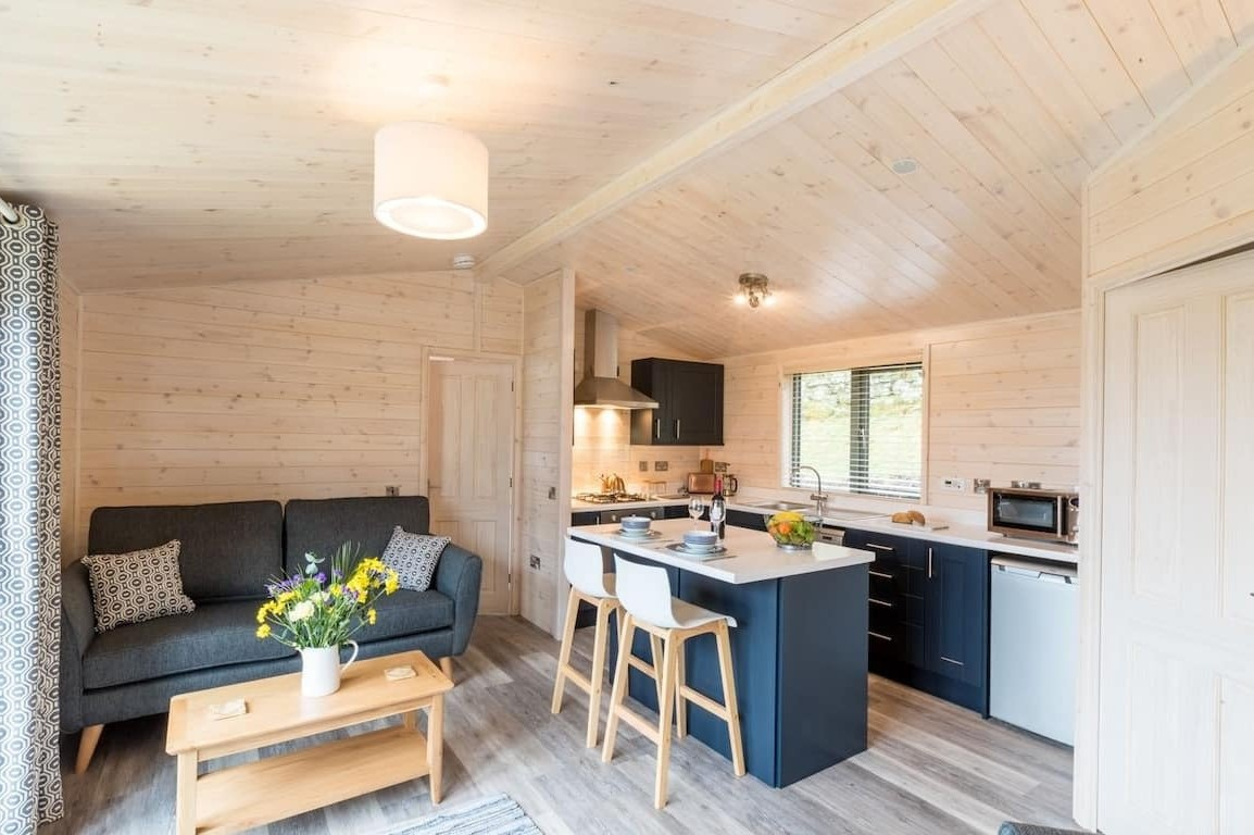 living-area-and-kitchen-of-high-borrans-wooden-cabin-in-windermere