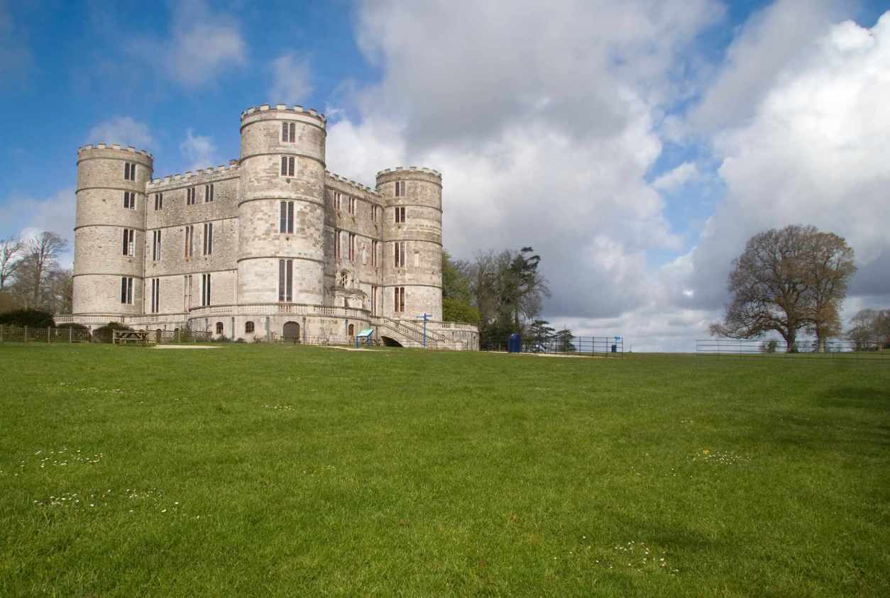 lulworth-castle-in-green-field-on-sunny-day