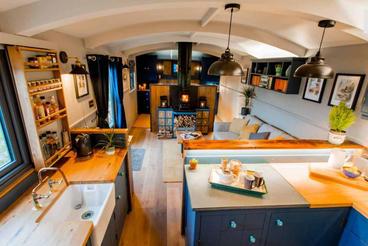 open-plan-kitchen-living-and-bedroom-area-of-top-farm-shepherds-hut