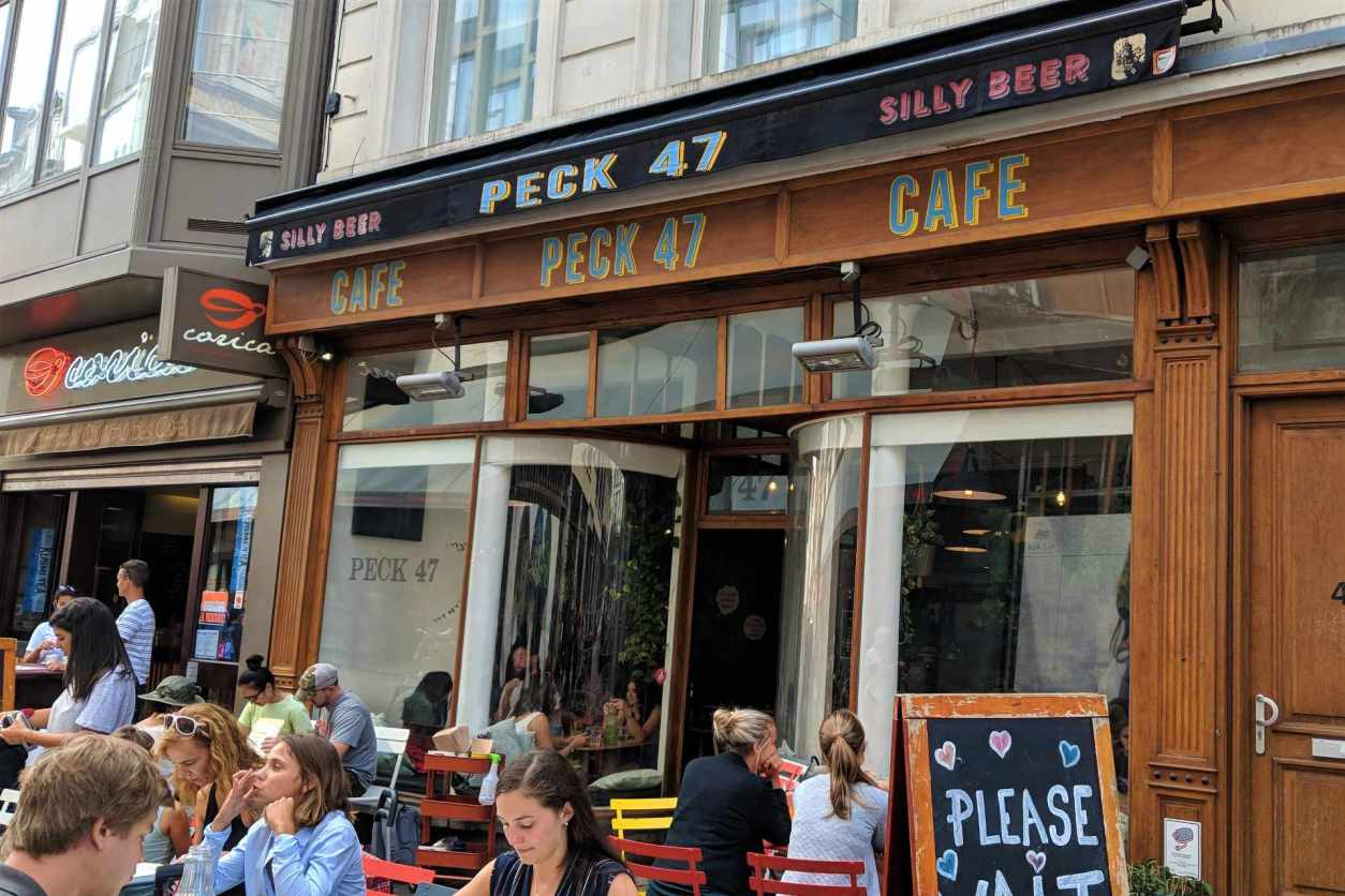 people-eating-outside-peck-47-cafe-in-daytime
