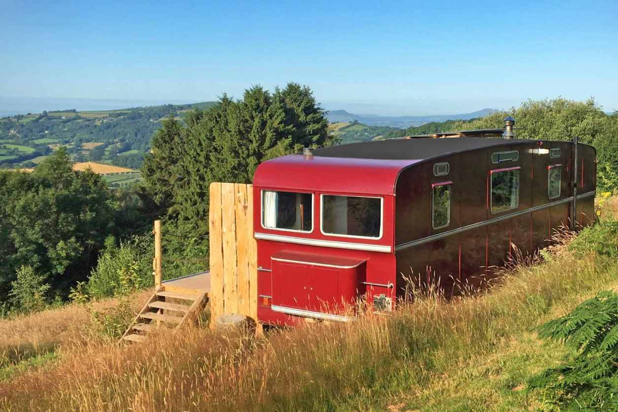 red-wagon-above-the-world-accommodation-on-hill-overlooking-countryside-views