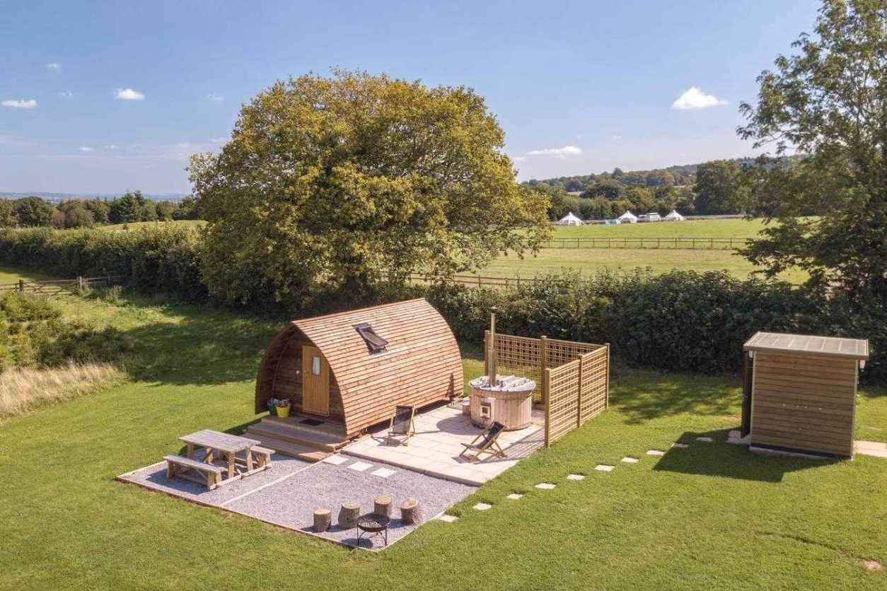 secret-valley-wigwam-pod-on-decking-with-hot-tub-in-field-somerset-glamping