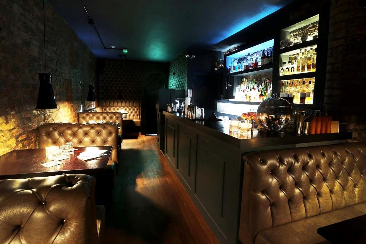 small-underground-bar-with-booths-in-dark-at-the-washhouse