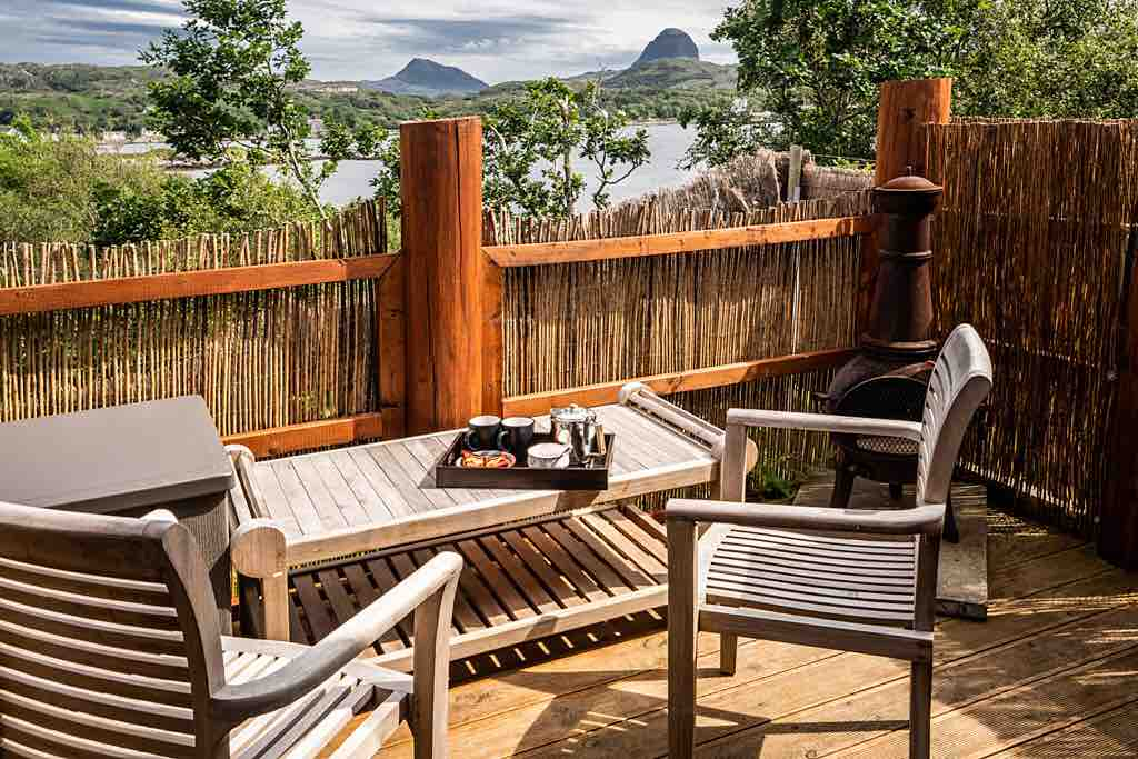 tables-and-decking-on-the-hideaway-patio-overlooking-lake