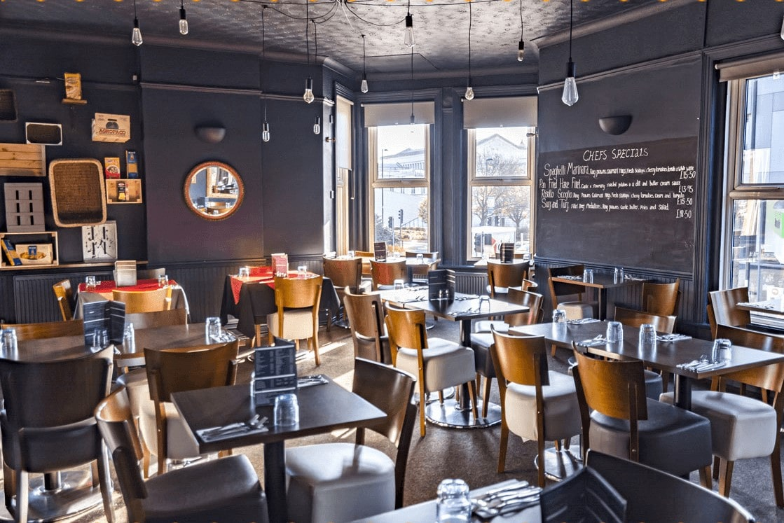 tables-in-grey-restaurant-room-at-gusto-lounge