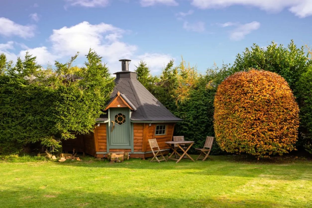 the-den-scandinavian-BBQ-cabin-in-field-on-sunny-day-airbnbs-lake-district