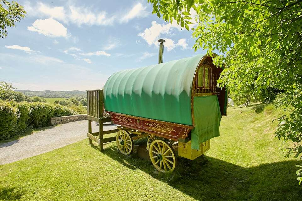 traditional-green-gypsy-caravan-in-field-in-ayside-on-sunny-day-airbnbs-lake-district