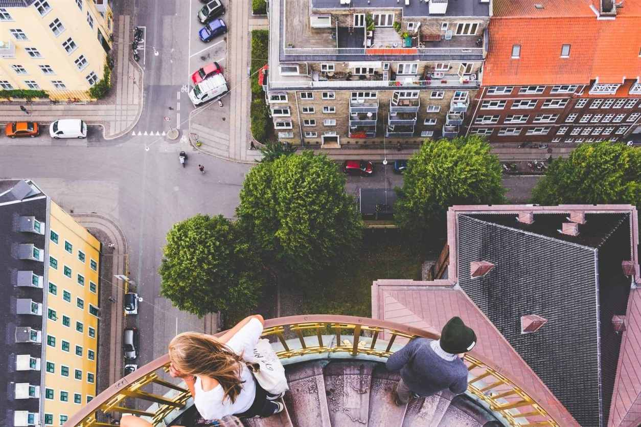 two-people-on-spiral-staircase-looking-down-at-city-below-from-the-church-of-our-saviour-3-days-in-copenhagen-itinerary