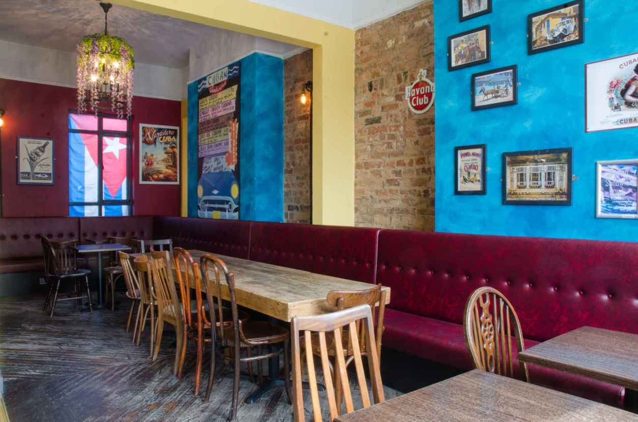 wooden-tables-and-chairs-in-the-cuban-embassy-restaurant
