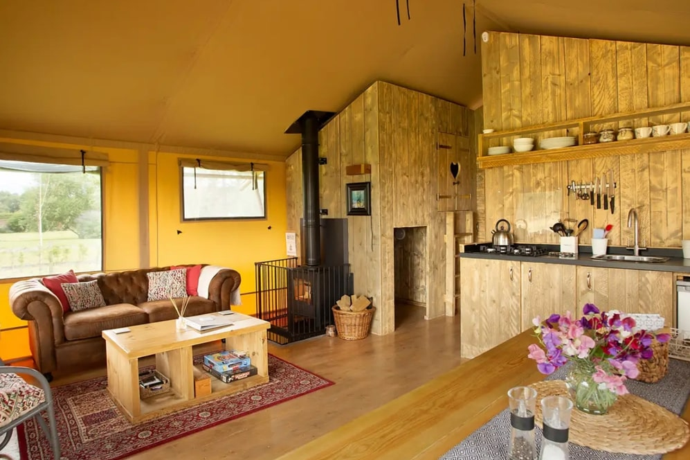 yellow-interior-living-and-kitchen-area-of-tall-trees-safari-tent