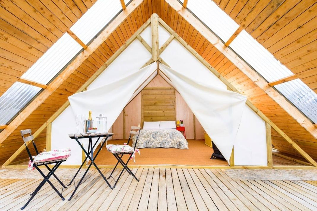 bed-inside-the-a-framed-grove-glamping-lodge-glamping-kerry