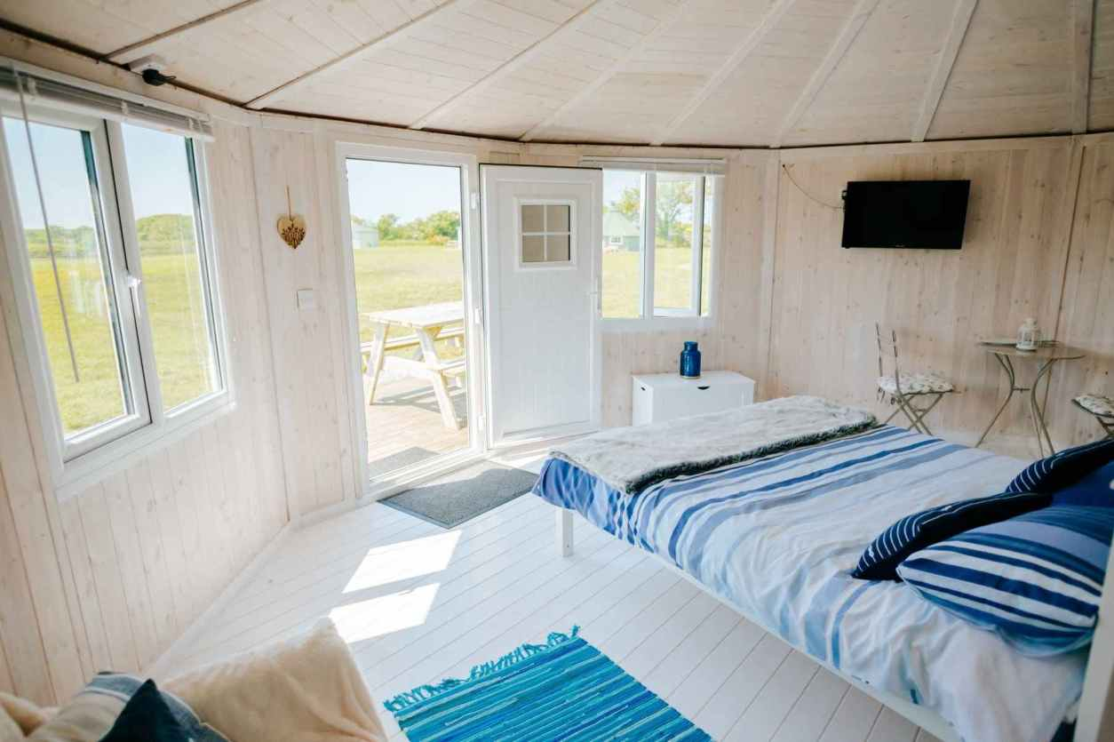 bed-sofa-and-table-inside-welcombe-mouth-cabin-lodges-with-hot-tubs-devon