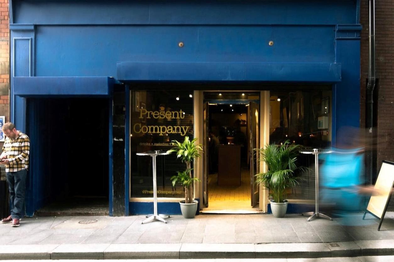 blue-exterior-of-present-company-bar