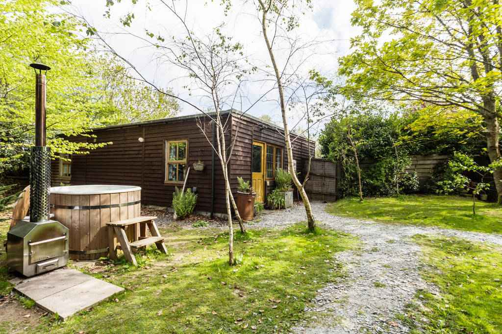 brown-pip-and-pips-cabin-in-garden-with-hot-tub