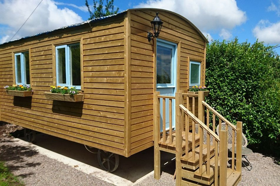 brown-ring-of-kerry-shepherds-hut-with-blue-door-glamping-kerry
