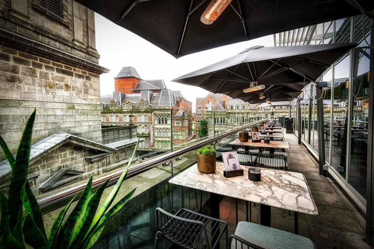 covered-terrace-at-the-alchemist-overlooking-church-and-city