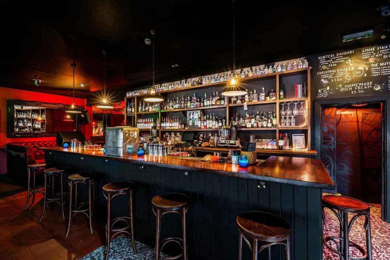 dark-bar-with-alcohol-at-santa-chupitos-bar
