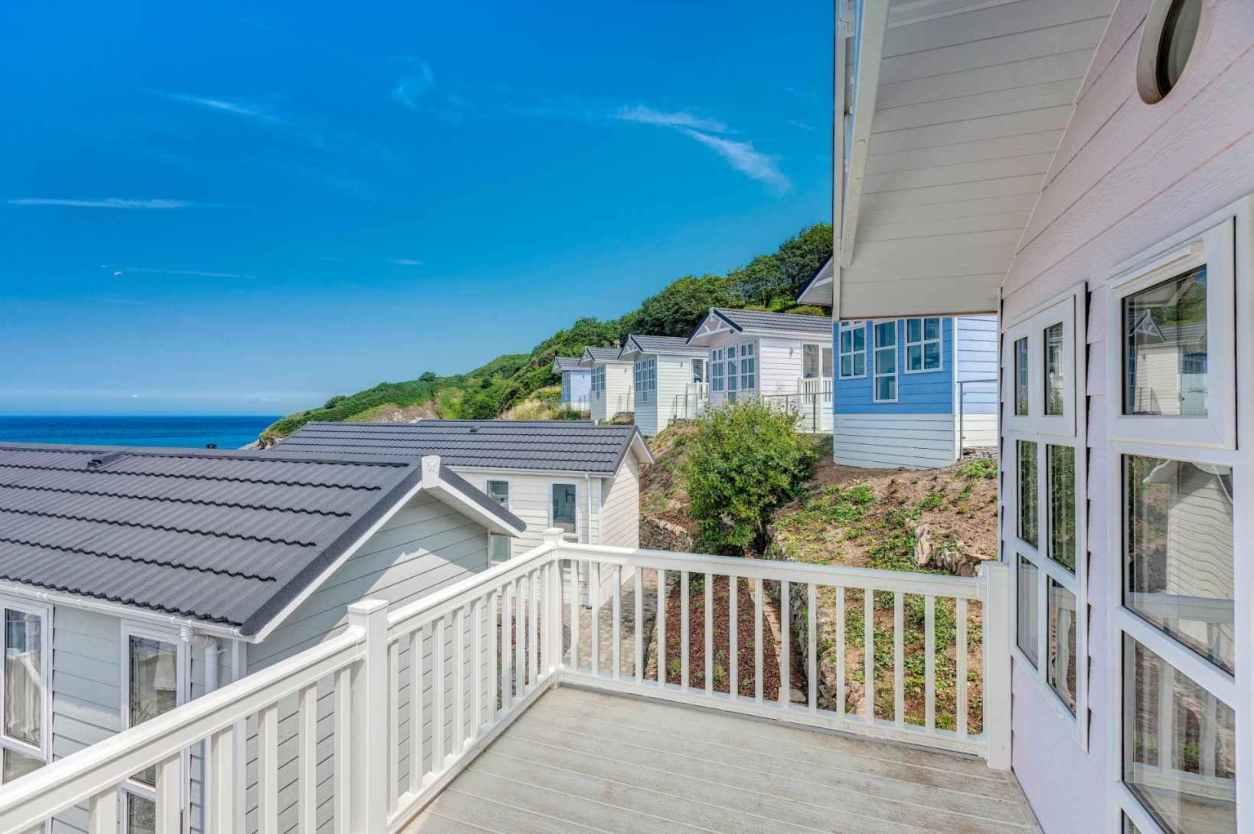 decking-of-white-coastal-lodges-at-beach-cove-coastal-retreat-lodges-with-hot-tubs-devon