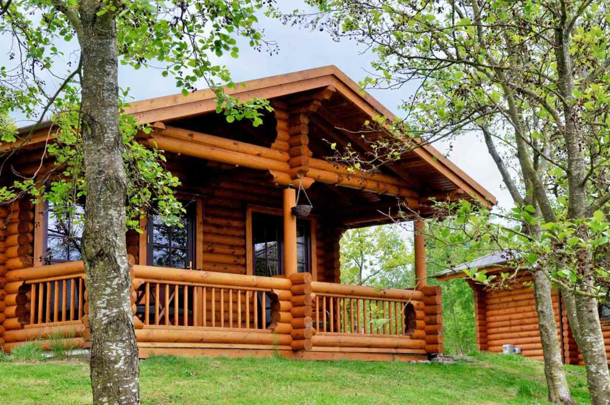 fontburn-log-cabin-with-decking-by-trees
