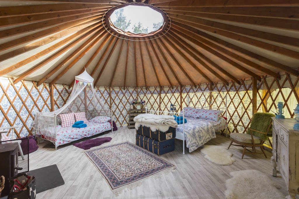 interior-of-bodichon-yurt-with-bed-at-glottenham-castle-glamping-sussex