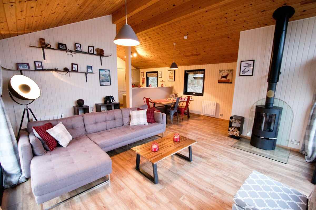 living-space-of-the-drey-lodge-with-sofa-and-woodburner-lodges-with-hot-tubs-northumberland