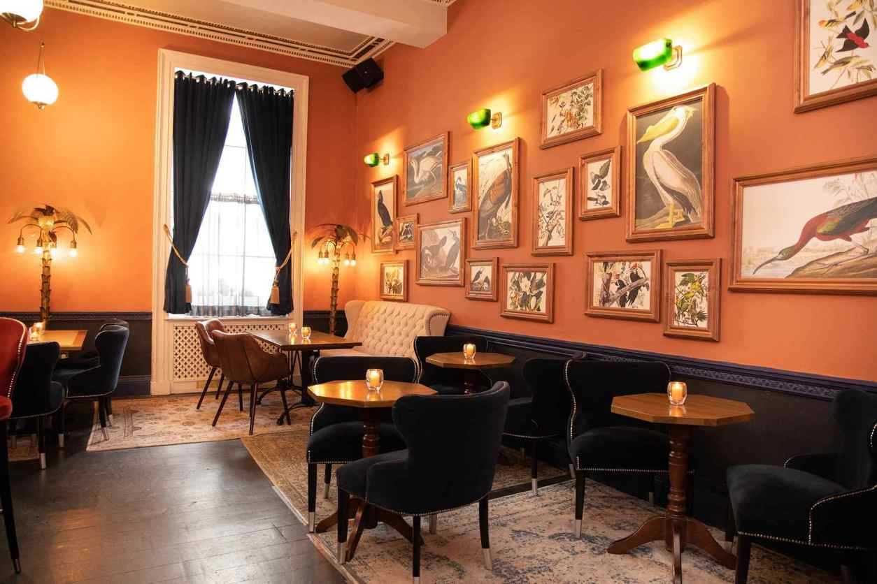 orange-walls-with-framed-painting-at-royal-institution-bar