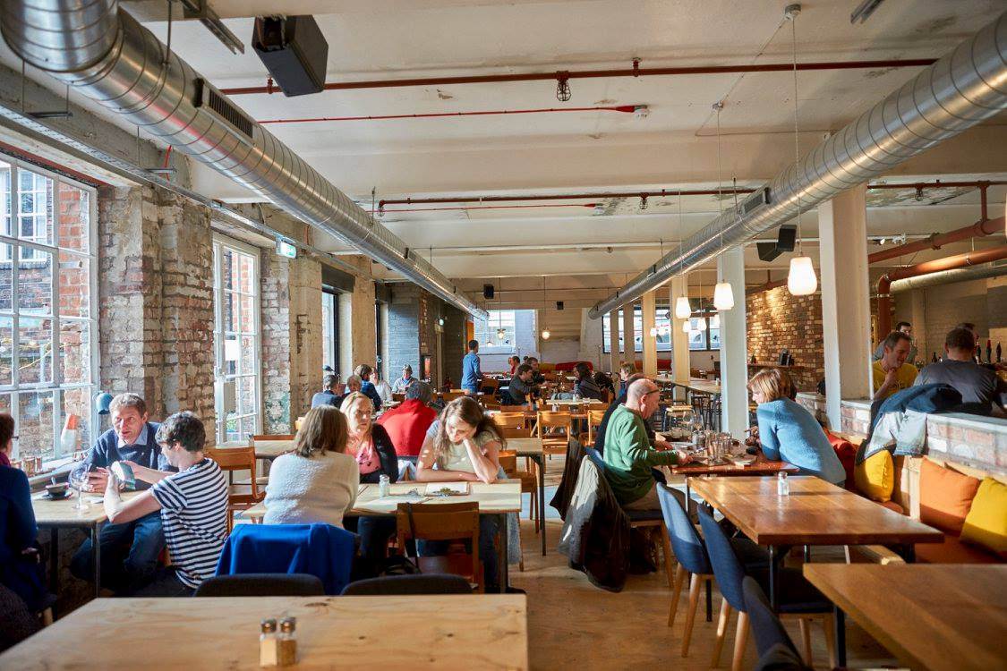 people-drinking-at-tables-inside-of-the-pen-factory-best-cocktail-bars-liverpool