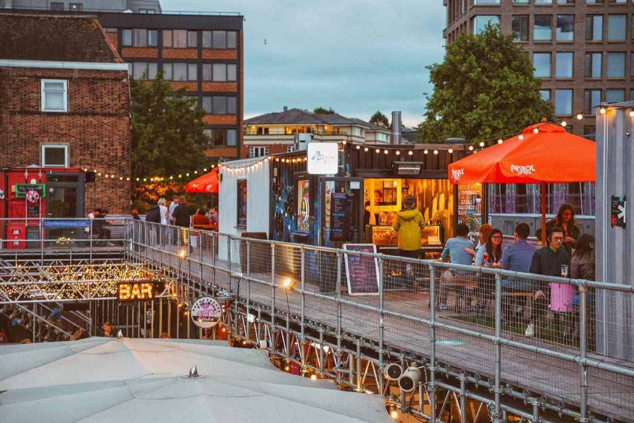 people-eating-by-shipping-containers-at-spark-york-at-dusk-free-things-to-do-in-york