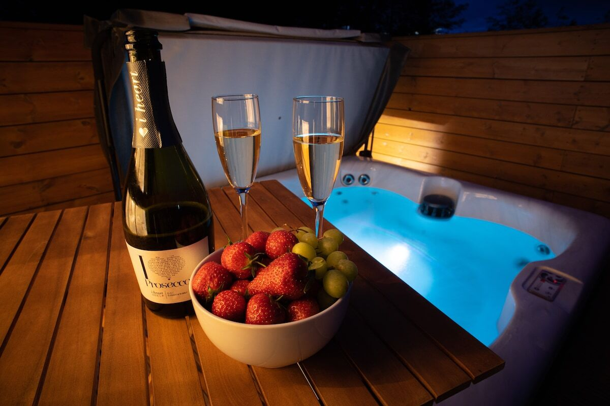 prosecco-strawberries-and-grapes-by-hot-tub-at-night-at-the-secret-garden-lodge