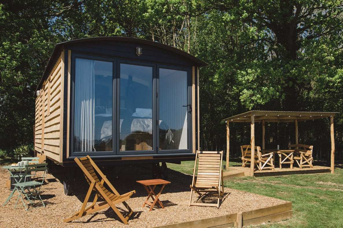 the-long-view-shepherds-hut-in-field-at-swallowtail-hill-glamping-sussex