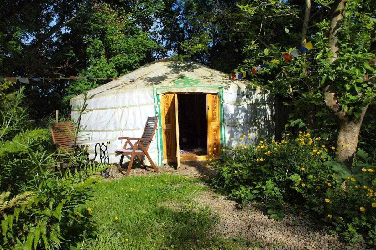 white-mongolian-yurt-among-trees-in-garden