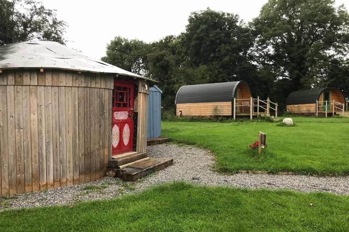 carrigeen-glamping-yurt-with-red-door-in-field